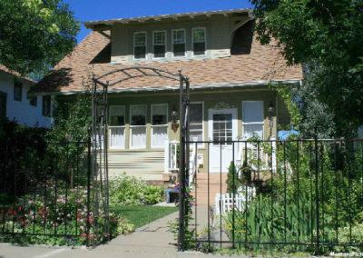 62607 glendive house iron fence corner 1604_MontanaPictures_Net