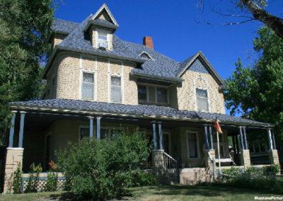 62607 glendive house orange flag 1627_MontanaPictures_Net