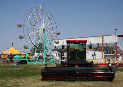 80506 sidney rides wheel and combine_MontanaPictures_Net