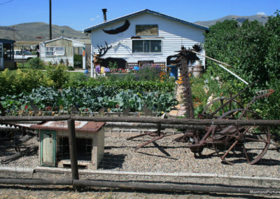 71907 Lima garden by log church 7619_MontanaPictures_Net